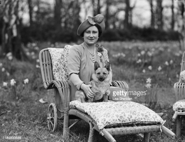 Elizabeth BowesLyon sits on a deckchair with a Pembroke Welsh Corgi dog in the grounds of the Royal Lodge in Windsor Great Park April 1940