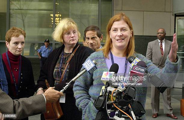 Elizabeth Buffy Hall Mary Maddux John Maddux and Meg Wakeman speak to the media during a break in the trial of Ira Einhorn outside the Criminal...