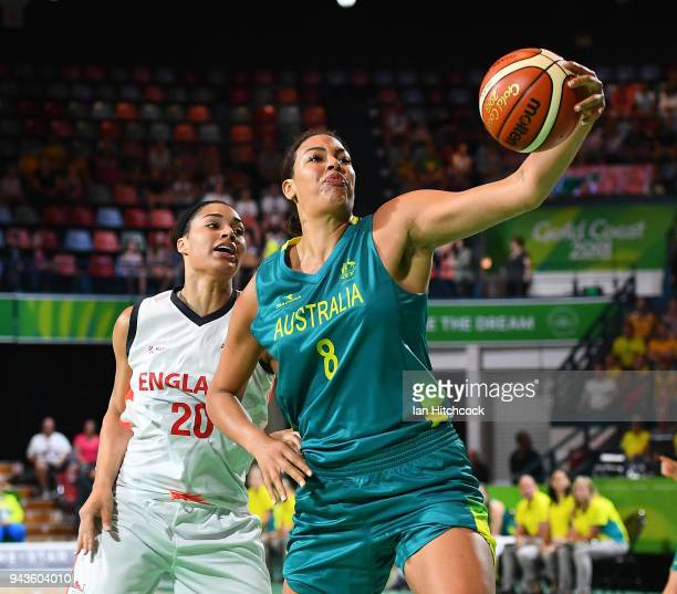 Elizabeth Cambage of Australia catchs the ball in front of Dominique Allen of England during the Preliminary Basketball round match between Australia...