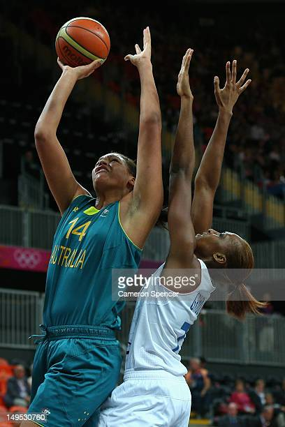 Elizabeth Cambage of Australia lays the ball up during the Women's Preliminary Round match between Australia and France on day 3 of the London 2012...