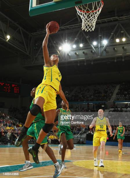 Elizabeth Cambage of Australia scores during the first match between the Australian Opals and Brazil at Hisense Arena on June 24 2012 in Melbourne...