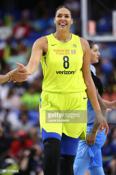 Elizabeth Cambage of the Dallas Wings highfives teammate during the game against the Chicago Sky on July 3 2018 at College Park Center in Arlington...