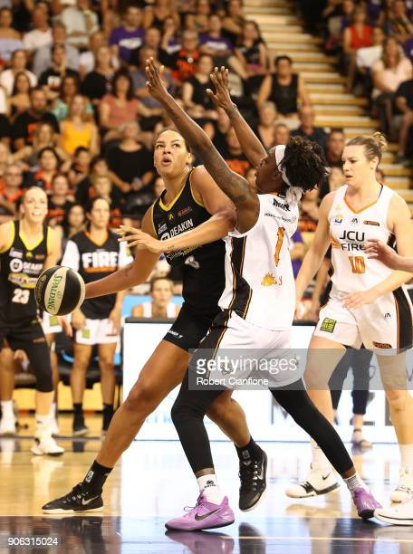 Elizabeth Cambage of the Melbourne Boomers is pressured by Laurin Mincy of the Townsville Fire during game two of the WNBL Grand Final series between...