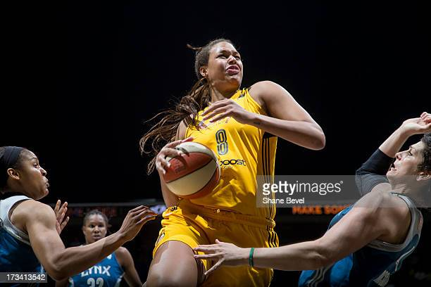 Elizabeth Cambage of the Tulsa Shock goes up for the basket during the WNBA game on July 13 2013 at the BOK Center in Tulsa Oklahoma NOTE TO USER...