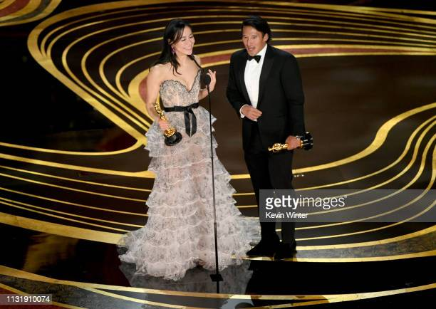 Elizabeth Chai Vasarhelyi and Jimmy Chin accept the Documentary award for 'Free Solo' onstage during the 91st Annual Academy Awards at Dolby Theatre...