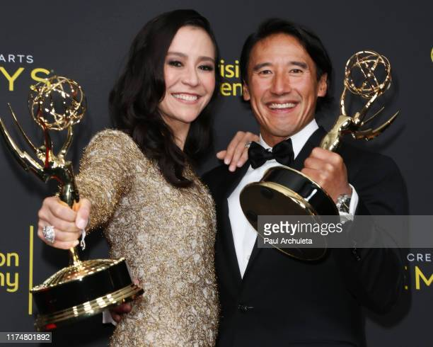 Elizabeth Chai Vasarhelyi and Jimmy Chin pose for photos in the press room for the 2019 Creative Arts Emmy Awards on September 14 2019 in Los Angeles...