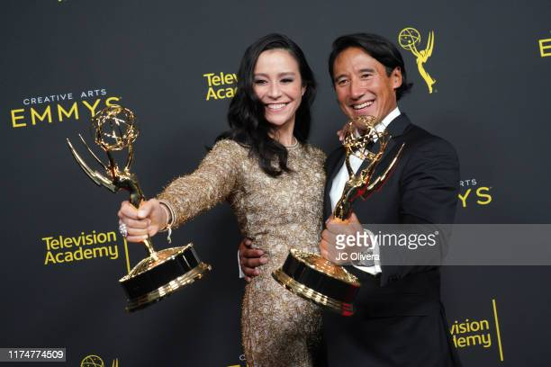 Elizabeth Chai Vasarhelyi and Jimmy Chin pose in the press room with their awards for outstanding directing for a documentary / nonfiction program...