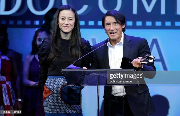 Elizabeth Chai Vasarhelyi and Jimmy Chin receive an award during the 3rd Annual Critics' Choice Documentary Awards at BRIC on November 10 2018 in New...