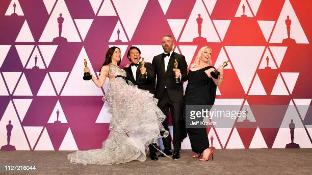 Elizabeth Chai Vasarhelyi Jimmy Chin Evan Hayes and Shannon Dill winners of Best Documentary Feature for 'Free Solo' pose in the press room during at...