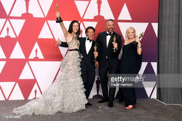 Elizabeth Chai Vasarhelyi Jimmy Chin Evan Hayes and Shannon Dill winners of Best Documentary Feature for Free Solo pose in the press room during the...