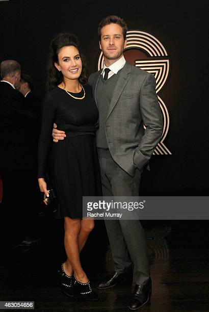 Elizabeth Chambers and actor Armie Hammer attend GQ and Giorgio Armani Grammys After Party at Hollywood Athletic Club on February 8 2015 in Hollywood...