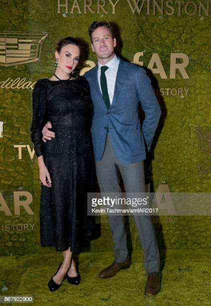 Elizabeth Chambers and Armie Hammer at TWO X TWO for AIDS and Art 2017 at The Rachofsky House on October 28 2017 in Dallas Texas