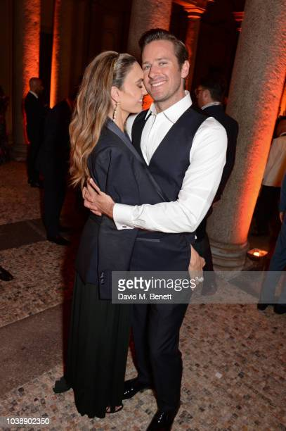 Elizabeth Chambers and Armie Hammer attend The Green Carpet Fashion Awards Italia 2018 after party at Gallerie d'Italia on September 23 2018 in Milan...