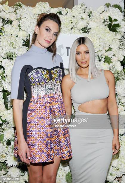 Elizabeth Chambers Hammer and Kim Kardashian West attend The Tot holiday popup celebration at Laduree at the Grove on December 4 2017 in Los Angeles...