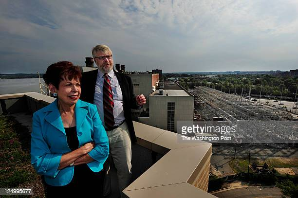 ALEXANDRIA VA SEPTEMBER 1 2011 Elizabeth Chimento and Poul Hertel stand on top of Alexandria's Marina Towers on September 1 2011 In background is...