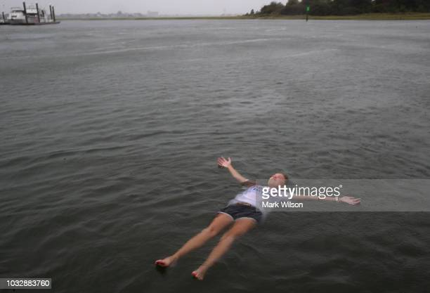 Elizabeth Claire Toomer floats while swimming with friends in the Intracoastal Waterway as Hurricane Florence approaches the area on September 13...