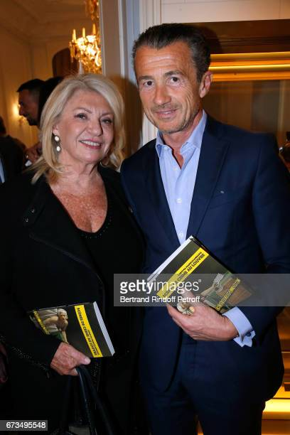 Elizabeth Dauchy and Francois Sarkozy attend the presentation of the Book 'Scenes De Crime au Louvre' written by Christos Markogiannakis at Greece...