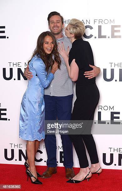 REQUIRED Elizabeth Debicki Armie Hammer and Alicia Vikander attend 'The Man from UNCLE' photocall at Claridge's Hotel on July 23 2015 in London...