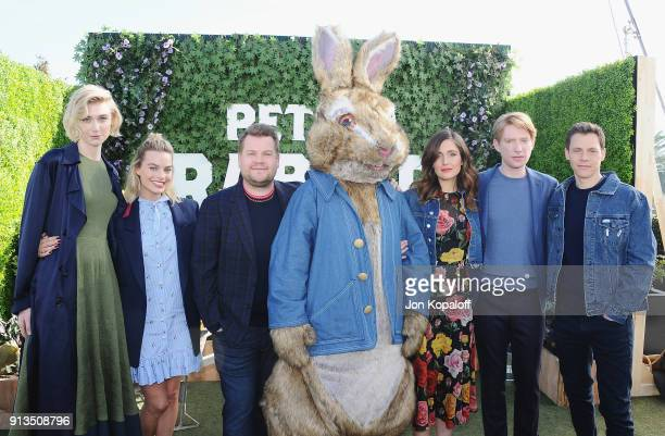 Elizabeth Debicki Margot Robbie James Corden Rose Byrne Domhnall Gleeson and director Will Gluck attend the photo call for Columbia Pictures' 'Peter...