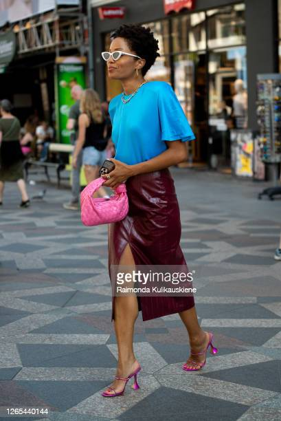 Elizabeth Delphine outside Rains wearing dark red leather skirt, blue t-shirt and pink bag during Copenhagen fashion week SS21 on August 11, 2020 in...