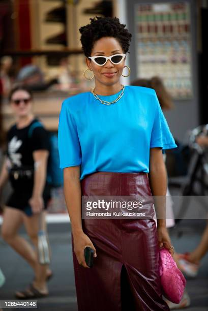 Elizabeth Delphine outside Rains wearing dark red leather skirt blue tshirt and pink bag during Copenhagen fashion week SS21 on August 11 2020 in...