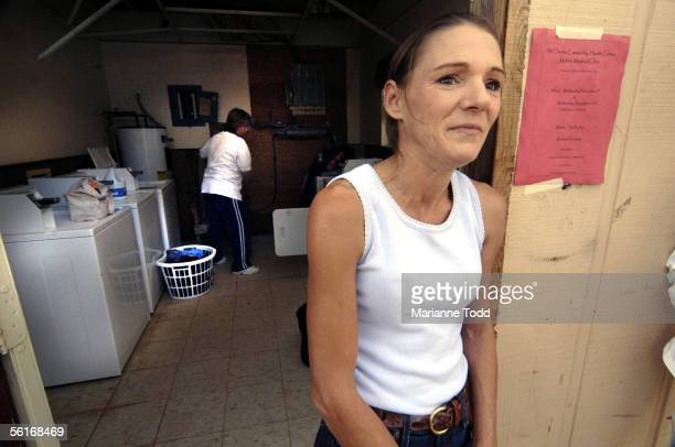 Elizabeth Dennis of Bay St Louis MS waits her turn to use the laundry facilities at a FEMA trailer park November 14 2005 in Kiln Mississippi The...