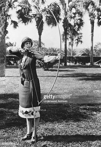 Elizabeth Detwiller gives a demonstration of her skills with the longbow at the Hotel Ormond Ormond Beach Florida February 9 1926 She is the only...