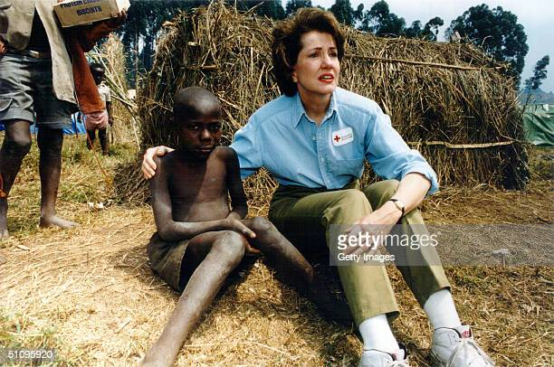 Elizabeth Dole President Of The American Red Cross Sits With A Orphaned Child His Family A Victim Of The Ethnic Killing In Rwanda August 1994...