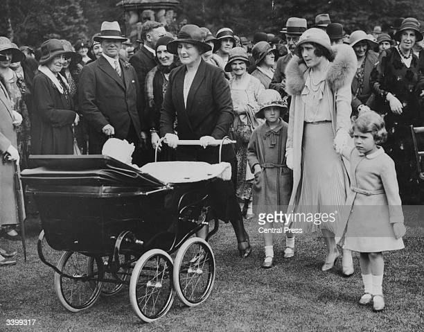 Elizabeth Duchess of York and Princess Elizabeth amongst guests at a garden party celebrating the Golden Wedding anniversary of her parents the Earl...