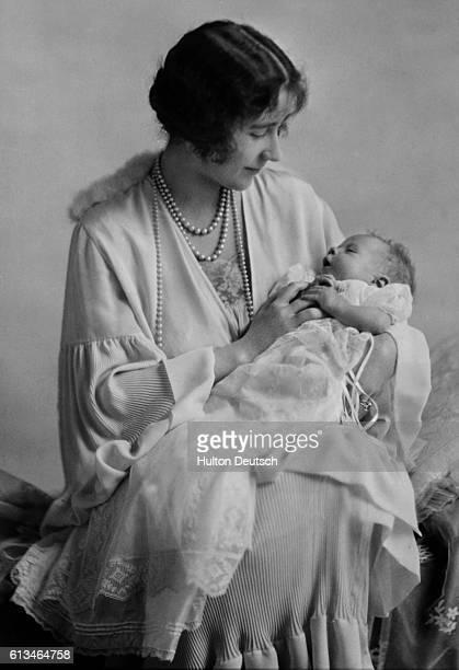 Elizabeth, Duchess of York holds her baby daughter Princess Elizabeth, the future Queen Elizabeth II of England.