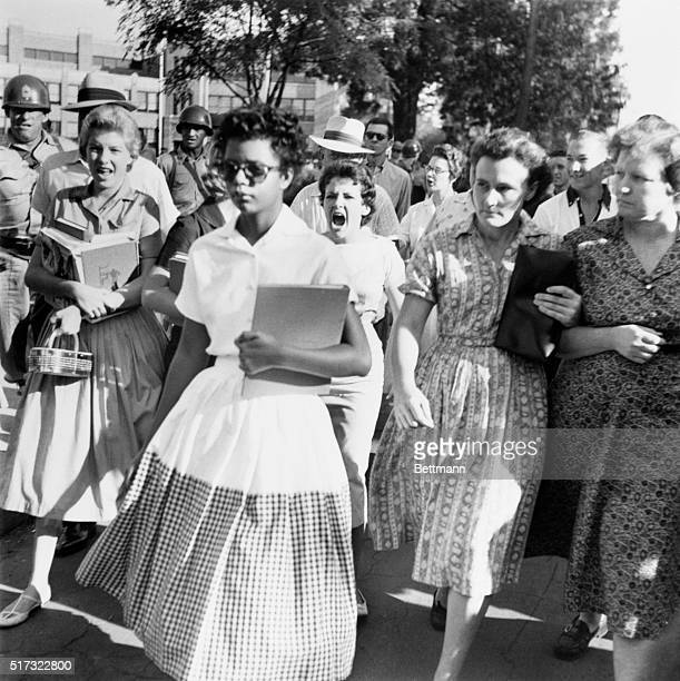 Elizabeth Eckford ignores the hostile screams and stares of fellow students on her first day of school, 6th September 1957. She was one of the nine...
