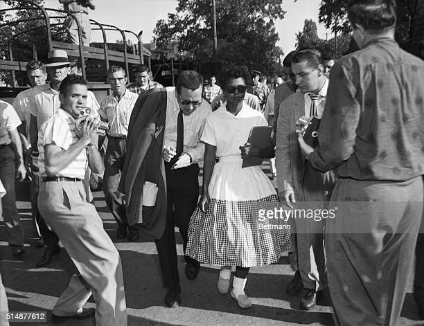 Elizabeth Eckford one of the Little Rock Nine is surrounded by journalists after she is prevented from entering Little Rock's Central High School by...