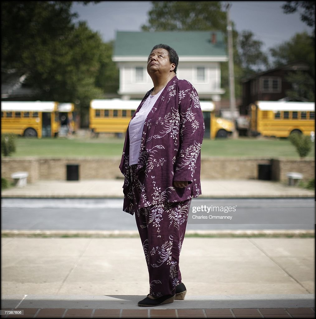 Elizabeth Eckford poses for a portrait on September 13, 2007 in front of the main entrance of Central High School in Little Rock, Arkansas. Threading her way though an angry mob as the Arkansas National Guard looked on, Eckford was the first of nine black schoolchildren to make history on September 4th, 1957 when she arrived, alone, for the first day of classes at the all-white high school.