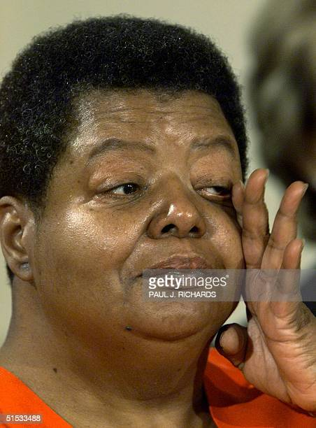 Elizabeth Eckford wipes her eyes during the presentation of the Congressional Gold Medal to the members of the Little Rock Nine 09 November in the...
