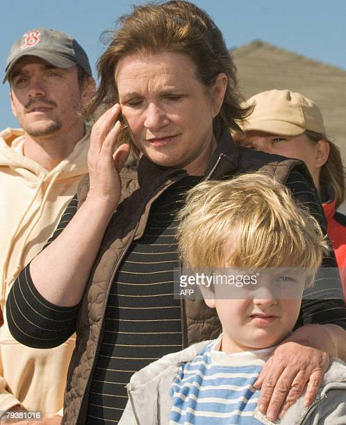 Elizabeth Edwards holds her son Jack 30 January 2008 as she reacts to her husband US presidential candidate former Senator John Edwards' speech in...