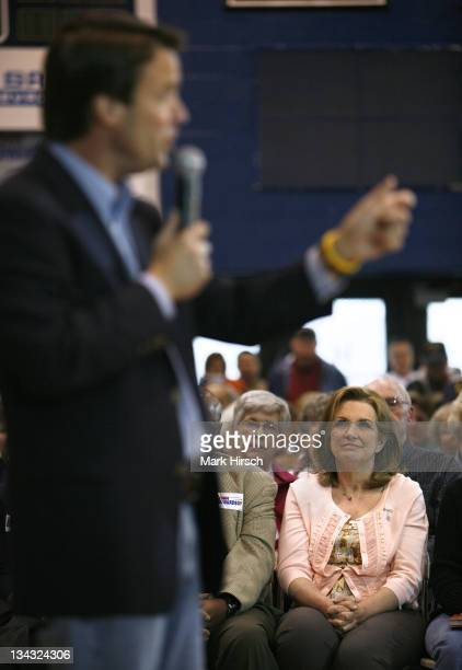 Elizabeth Edwards wife of Democratic Presidential hopeful John Edwards listens to her husband as he speaks to a large crowd gathered to hear him...