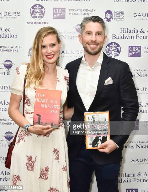 Elizabeth Flock and Lance Richardson attend Authors Night At East Hampton Library on August 11 2018 in East Hampton New York
