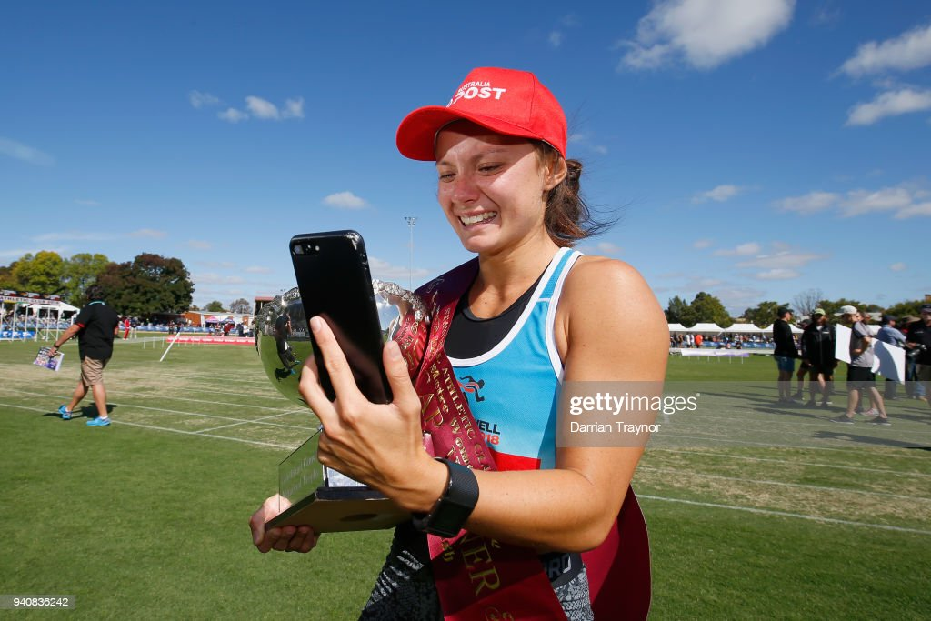Elizabeth Forsyth takes a phone call straight after winning the Women's Stawell Gift on April 2, 2018 in Stawell, Australia.