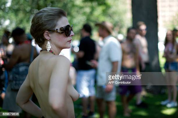 Elizabeth Gauss of Denver Colorado waits for the 2017 GoTopless Day Parade to begin on August 26 2017 in Denver Colorado Founded in 2007 by the...