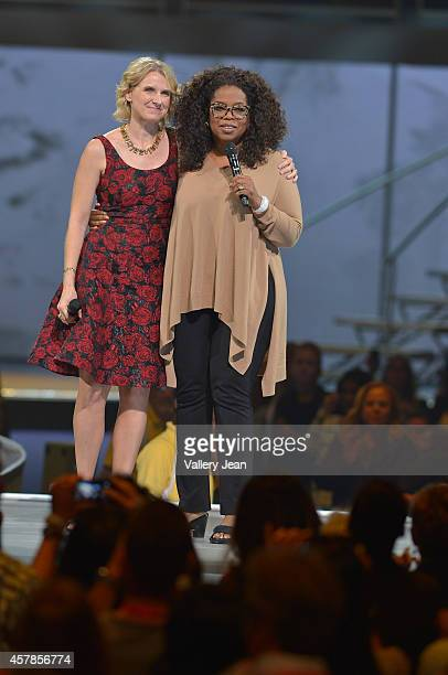 Elizabeth Gilbert and Oprah onstage at Oprahs The Life You Want Weekend at American Airlines Arena on October 25 2014 in Miami Florida