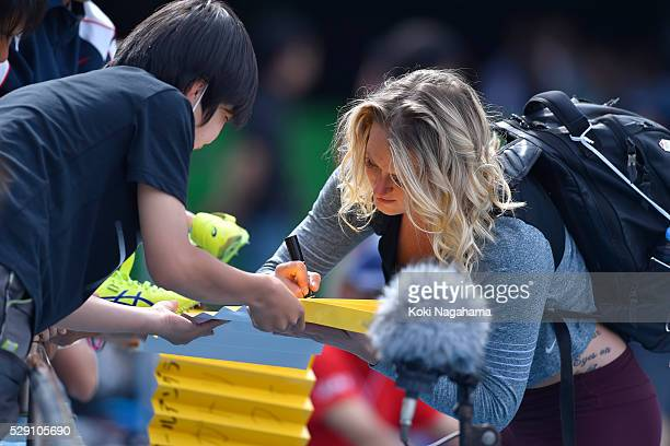 Elizabeth Gleadle of Canada signs an autograph after winning the Women's Javelin during the SEIKO Golden Grand Prix 2016 at Todoroki Stadium on May...