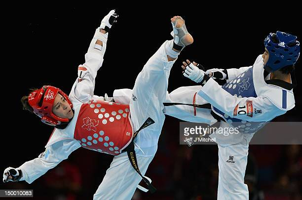 Elizabeth Gordillo Zamora of Guatemala competes against Chantip Sonkham Thailand during the womans 49kg Taekwondo Bronze medal match on Day 12 of the...