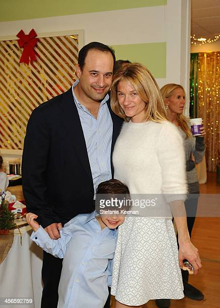 Elizabeth Guber and family attend the Third Annual Baby2Baby Holiday Party presented by The Honest Company on December 14 2013 in Los Angeles...