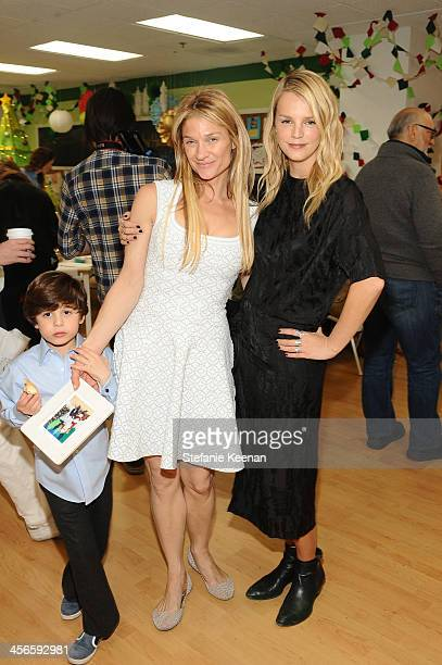 Elizabeth Guber and Kelly Sawyer attend the Third Annual Baby2Baby Holiday Party presented by The Honest Company on December 14 2013 in Los Angeles...
