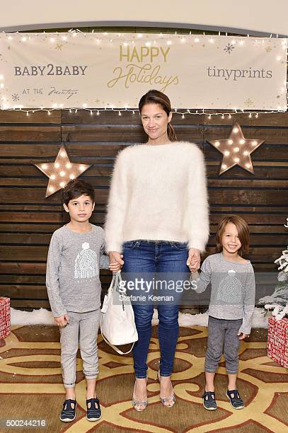 Elizabeth Guber Sugarman and sons attend the Baby2Baby Holiday Party Presented By Tiny Prints At Montage Beverly Hills on December 6 2015 in Beverly...