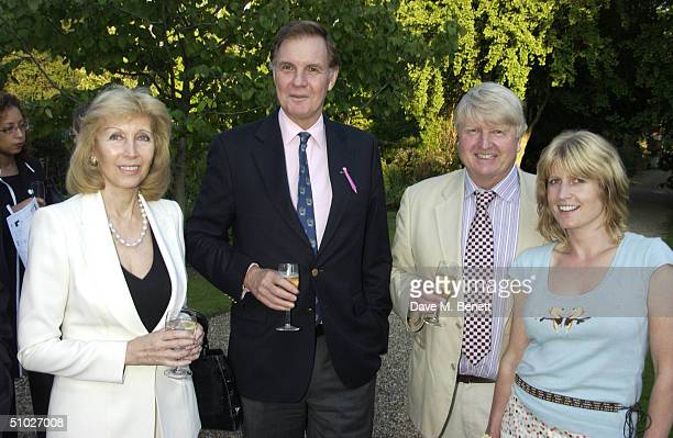 Elizabeth Harris, former MP Jonathan Aitken, Stanley Johnson and guest attend the Kit-Kat Club garden party, founded by Ghislaine Maxwell, to help...
