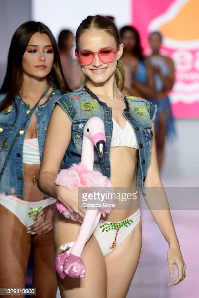 Elizabeth Hernly walks the runway for Mango Beach Swimwear during Orlando Swim Week Powered By hiTechMODA on July 18, 2021 in Orlando, Florida.
