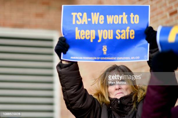 Elizabeth Hughes holds a placard stating TSA We work to keep you safe while demonstrating with Philadelphia Airport TSA and airport workers outside...