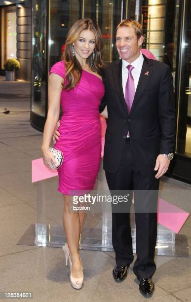 Elizabeth Hurley accompanied by boyfriend Shane Warne attends Estee Lauder Companies' Breast Cancer Awareness Campaign in TSUM on October 6 2011 in...