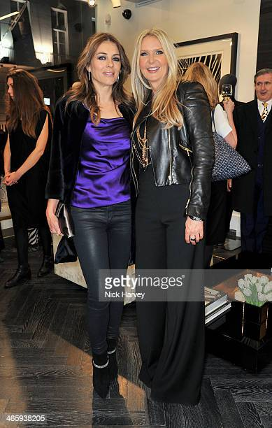 Elizabeth Hurley and Amanda Wakeley attend the opening of the new Amanda Wakeley store on January 30 2014 in London England